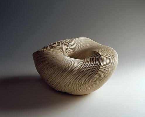 Large, attened undulating vessel with diagonally incised cascading folds