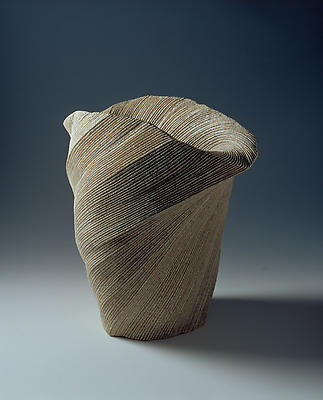 Large, undulating vessel with large mouth and diagonally incised cascading folds