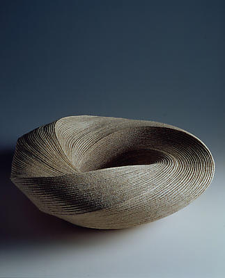 Large, attened round vessel with diagonally incised cascading folds 