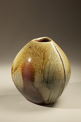 "Rounded three-sided <i>Tanba</i> vessel with three scored ""seams"" and dripping natural ash and red <i>akadobe</i> glazing, 2010 Wood-fired stoneware 15 x 14 1/4 inches; Inv# 6890"