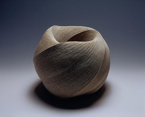 Large, globular vessel with diagonally incised cascading folds