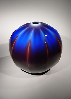 Shinkô Yôsai: Kyûryô tsubo; Brilliant glazes: Nine-sided Vase 2005 Porcelain with suffusion of deep brilliant kutani glazes 9 1/4 x 8 3/4 inches Private Collection, NY