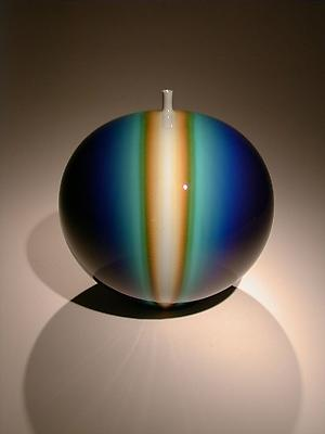 Blue globular vase with infused blue and yellow and a protruded mouth 2003 Porcelain with a suffusion of Kutani color glaze 10 1/8 x 9 1/4 inches Private Collection, MD