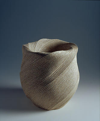Undulating vessel with diagonally incised cascading folds
