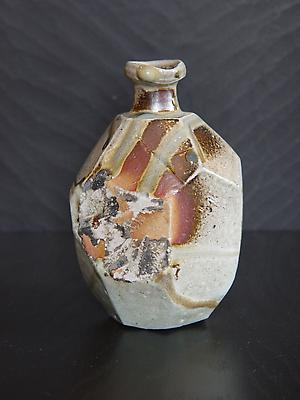 Faceted <i>Tanba tokkuri</i> (sake flask) with light glaze and dripping green ash glaze, 2011 Wood-fired stoneware with natural ash glaze and kiln effects 6 x 4 3/8 inches; Inv# 6937 SOLD