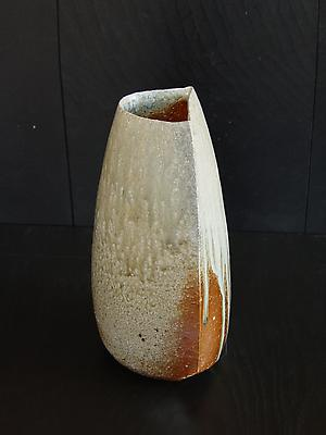 Tilting <i>Tanba</i> vase with moon-shaped opening and natural dripping  ash glaze; 2011 Wood-fired stoneware with ash glaze 12 x 6 7/5 x 6 1/4 inches; Inv# 6930