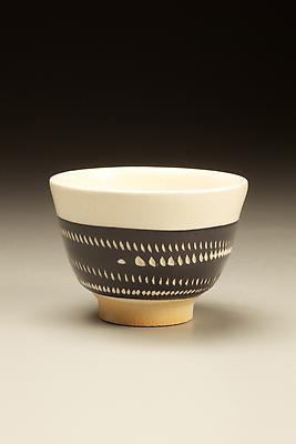 Textured black glazed stoneware sake cup with impressed patterning and white slip inlay, 1975 Textured black glazed stoneware, white slip inlay impressed areas  2 x 2 3/4 x 2 5/8 in. Inv# 7008 $ 875 Image