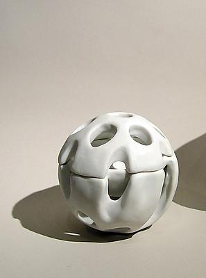 Small globular lidded container with round perforations, 2007