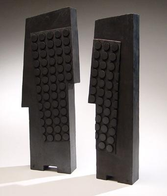 Pair of free-standing flat black sculpture forms with circular surface patterning ca. 1980 Smoke-blackened stoneware (A) 19 1/4 x 5 5/8 x 2 1/4 in.  (B) 20 1/2 x 7 1/2 x 2 1/4 in. Inv# 3897 SOLD Image