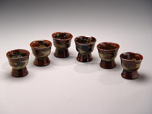 Ueda Tsuneji (1914-1980) Set of six <i>nerikomi</i> sake cups with brown, black, beige abstract patterning on elevated foot, ca. 1968 Glazed stoneware 2 3/8 x 2 1/2 inches Inv# 4353