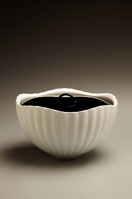 Ono Kotaro (b. 1953) Water jar with curved fluted surface and lacquer lid Porcelain with <i>hakushi</i> glaze and black lacquer lid 4 1/2 x 7 3/4 x 7 3/4 inches Inv# 6085