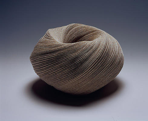 Ovoid vessel with diagonally incised cascading folds