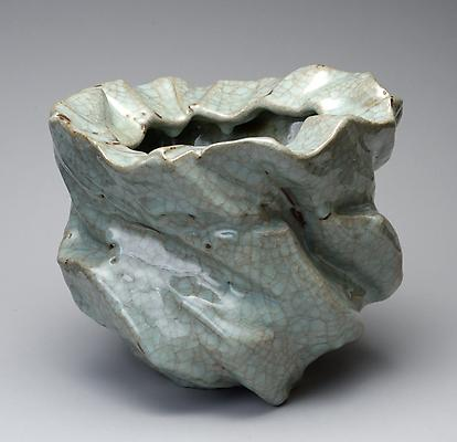 Okabe Mineo (1919-1990) Irregular sculpted twisting vessel  Stoneware with crackled celadon glaze 9 x 10 7/8 in. With original signed box Sold