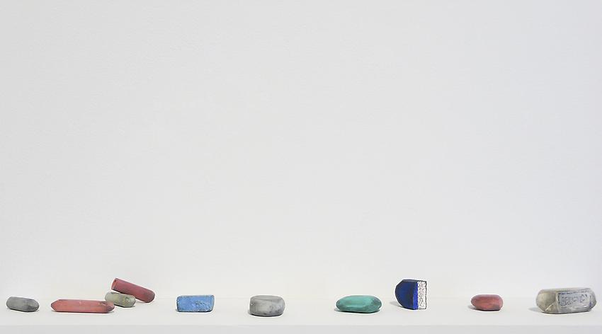 DAVID ADAMO<br /><i>Untitled (10 erasers)</i><br />2012<br />tempera on clay<br />shelf: 4 1/2 x 20 inches <br />  (11.4 x 50.8 x cm)<br />