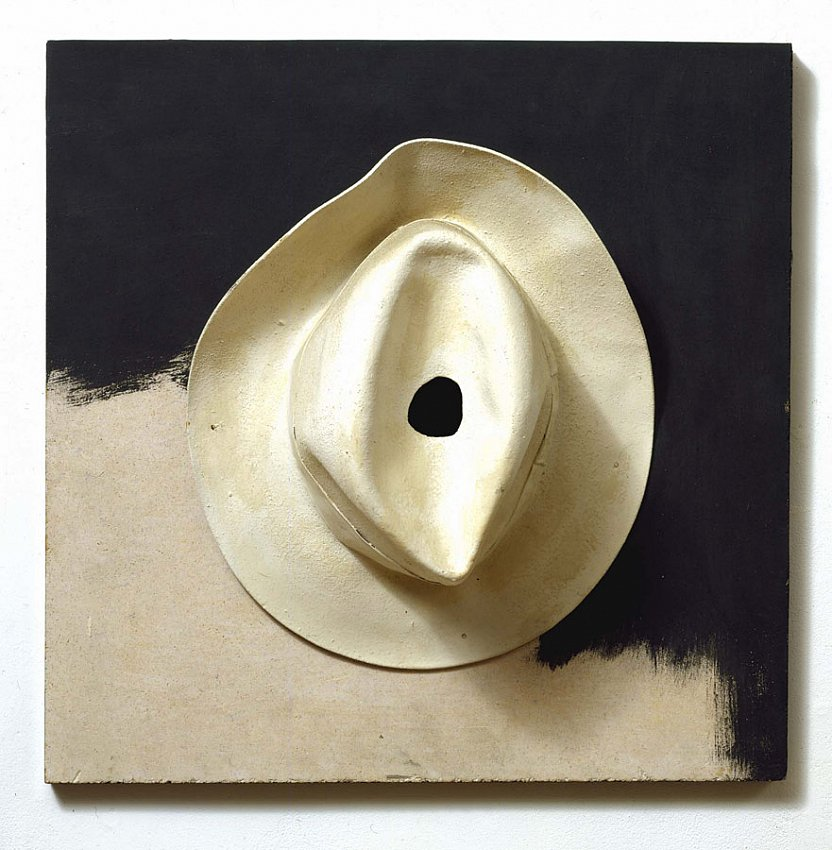 MARCEL BROODTHAERS		(1924 - 1976)<br /><i>Chapeau blanc</i><br />1965<br />oil on felt hat and panel<br />17 1/2 x 17 3/4 x 5 3/4 inches (44.7 x 45 x 14.6 cm)<br />