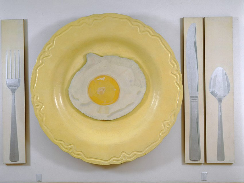<u>Egg on Plate with Knife, Fork, and Spoon</u><br />1964<br />spray acrylic and stencil on linen; painted fiberglass;  in four panels<br />86 x 140 1/4 x 6 3/4 inches (218.4 x 356.2 x 17.1 cm)<br />