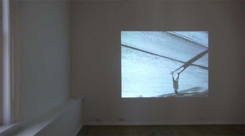 FIONA TAN<br />Downside Up<br />2002<br />Betacam saftey master, table-top projector, dvd player, amplifier, speakers, pedistal<br />