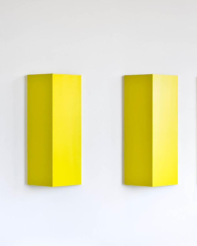Charlotte Posenenske<br />Relief, Series B, 1967<br />RAL yellow spray paint on sheet aluminum, convexly folded<br />39 3/8 x 19 5/8 x 5 1/2 inches<br />