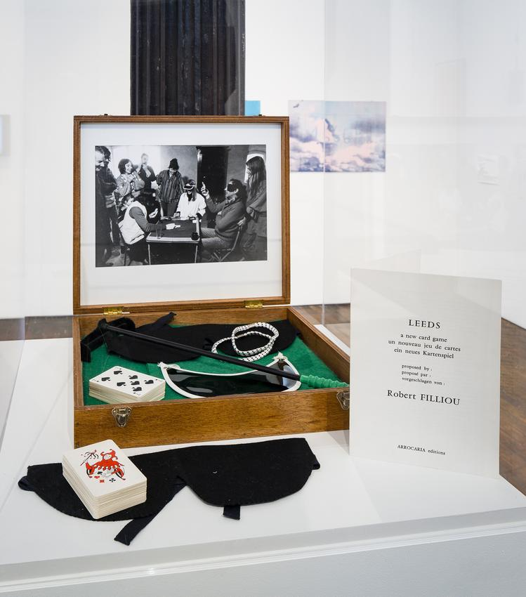 <i>Leeds Game</i><br /><br />1976<br />wooden box including an original black and white photograph, folded card with rules, croupier's rake, two black felt blindfolds, one play area made from green felt, two elastic sleeve holders, one eyeshade, fifty-four playing cards, and one certificate<br />13 1/8 x 14 5/8 x 2 5/8 inches<br />  (33.3 x 37.1 x 6.7 cm)<br />Edition 22 of 100<br />Published by ARROCARIA, Antibes, France<br />PF4908<br />