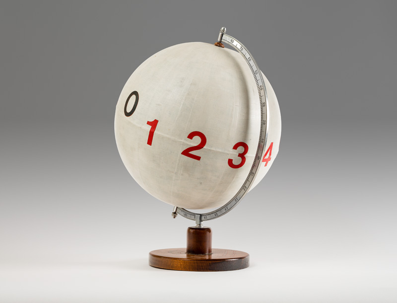 Dimitrije Bašičević Mangelos (1921-1987)<br /><br />Numberconcept Pitagoras<br />1977-1978<br />plastic letters, acrylic on globe made from wood, metal and paper<br />18 1/8 x 14 x diameter 13 1/8 inches<br /> (46 x 35.6 x diameter 33.3 cm)<br />PF2279<br />
