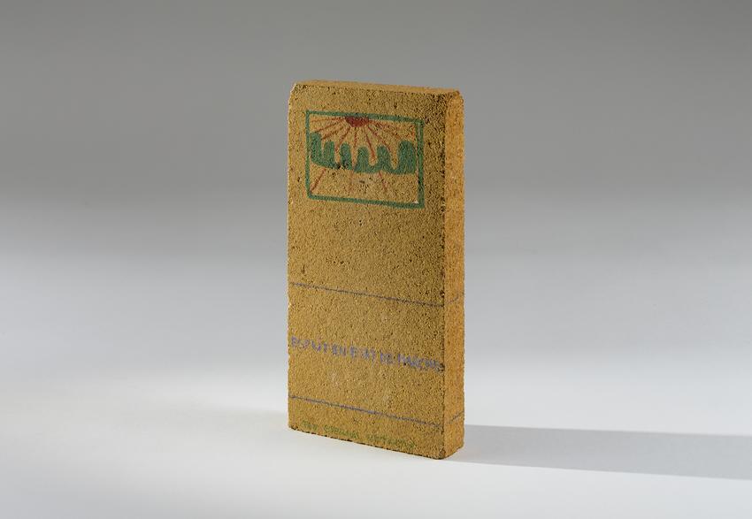 <i>Esprit en état de marche [Mind in Progress]</i><br /><br />1980-1984<br />felt pen and pastel on yellow brick<br />8 5/8 x 4 3/8 x 1 1/4 inches<br />  (21.9 x 11.1 x 3.2 cm)<br />PF4888<br />