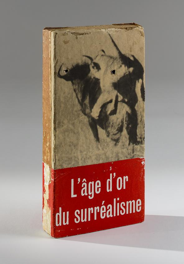 <i>L'âge d'or du surréalisme [Golden Age of Surrealism]</i><br /><br />1980-1984<br />glued paper, tape, printed paper band and mollies on<br />   yellow brick<br />8 5/8 x 4 3/8 x 1 1/4 inches<br />  (21.9 x 11.1 x 3.2 cm)<br />PF4893<br />