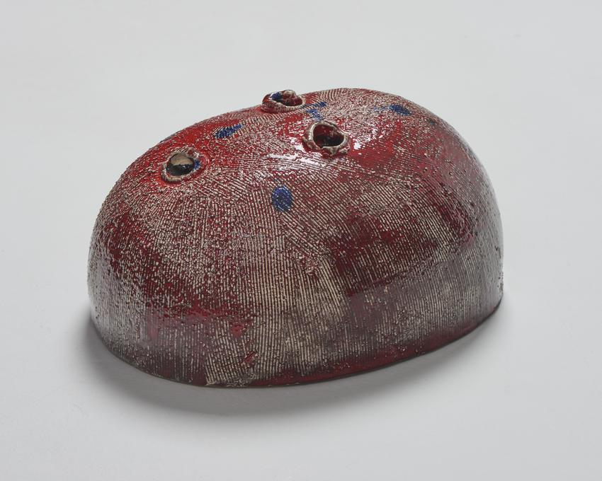 Thomas Schütte<br /><i>Eierkopf, halb</i><br />2014<br />glazed ceramic with artist's wood base<br />6 3/4 x 10 3/8 x 13 13/16 inches<br />  (17.1 x 26.4 x 35.1 cm)<br />PF3540<br />