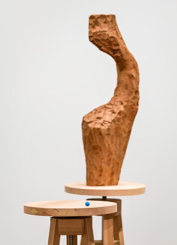 David Adamo<br /><br />Untitled (vessel and M&M)<br />2014-2016<br />western red cedar in three parts, metal, and acrylic on cast bronze<br />overall: 74 1/2 x 39 3/4 x 16 3/4 inches<br />     (189.2 x 101 x 42.5 cm)<br />stools: 48 3/4 x 18 x 16 3/4 inches <br />        and 47 7/8 x 18 1/4 x 17 1/2 inches<br />      (123.8 x 45.7 x 42.5 cm <br />        and 121.6 x 46.4 x 44.5 cm)<br />vessel: 26 3/8 x 9 7/8 x 3 15/16 inches<br />   (67 x 25 x 10 cm)<br />M&M: 7/16 x 5/8 x 1/2 inches<br />   (1.1 x 1.6 x 1.3 cm)<br />PF3390<br />