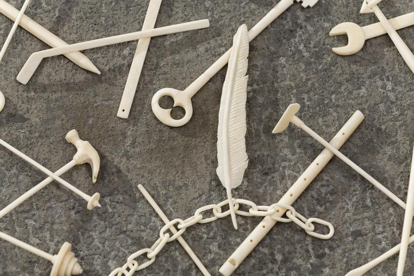<u>Jack Straws</u> (detail)<br />2015-16<br />human bone<br />dimensions vary<br />cement base: 24 5/8 x 24 5/8 x 3/8 inches (62.5 x 62.5 x 1 cm)<br />