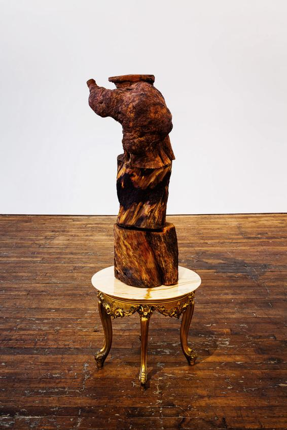 JIMMIE DURHAM<br /><i>An Intervention of Red Bud</i><br />2012<br />olive tree trunks, marble table<br />61 1/16 x 23 5/8 x 23 5/8 inches<br />  (155 x 60 x 60 cm)<br />PD3677, JD7851<br />