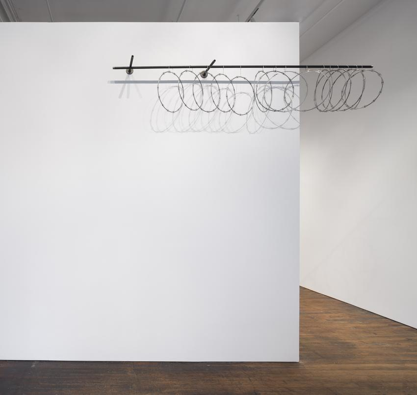 <u>Curtilage</u>, 2017<br />razor wire, soldered galvanized cable, steel pipe, and steel brackets<br />22 x 120 x 15 1/4 inches (55.9 x 304.8 x 38.7 cm)<br />