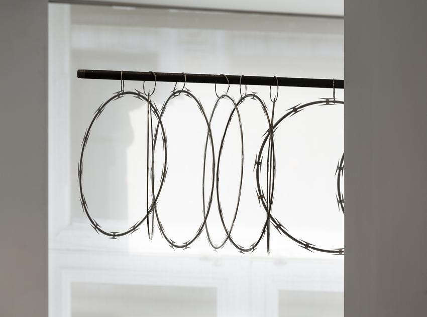 <u>Curtilage</u> (detail), 2017<br />razor wire, soldered galvanized cable, steel pipe, and steel brackets<br />22 x 120 x 15 1/4 inches (55.9 x 304.8 x 38.7 cm)<br />