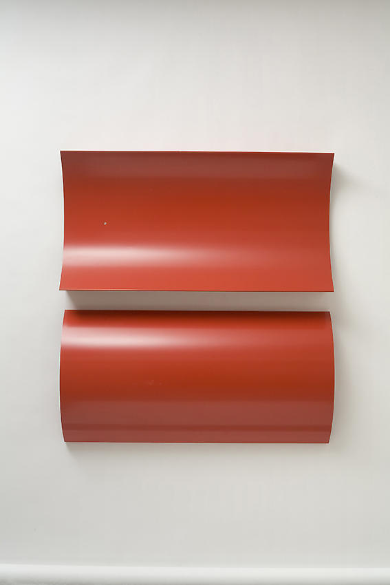 CHARLOTTE POSENENSKE<br /><i>Relief, Series B</i><br />1967<br />RAL red spray paint on sheet aluminum, concavely and convexly arched<br />39 3/8 x 19 5/8 x 5 1/2 inches (100 x 49.8 x 13.9 cm)<br />
