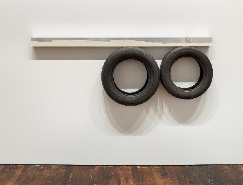 Pedro Cabrita Reis<br /><br />One Line (horizontal), Two Circles Underneath<br />2014<br />enamel on welded aluminum tubing, found car tires<br />30 x 82 x 9 1/4 inches<br />(76 x 208 x 23.5 cm)<br />PF3362<br />