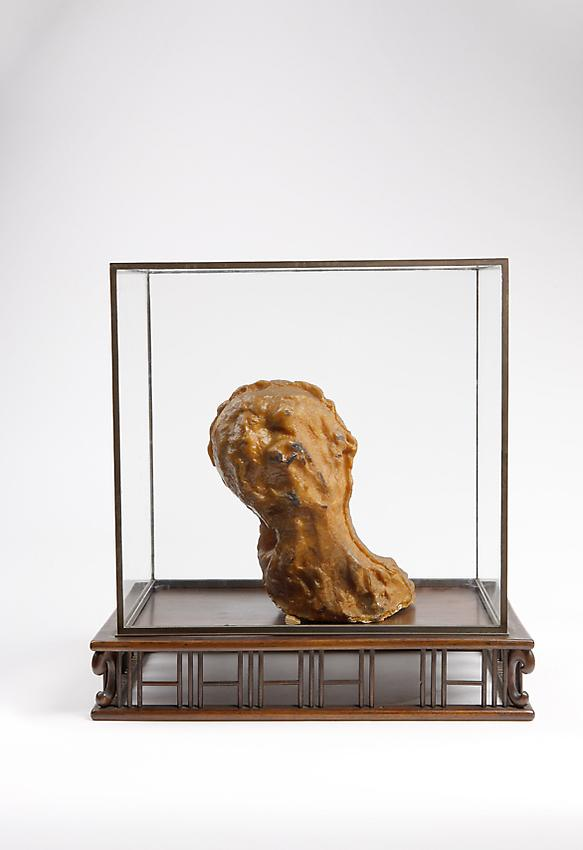 Medardo Rosso<br />Bambino malato<br />c. 1895<br />wax over plaster<br />6 3/4 x 5 7/8 x 10 inches<br />(17 x 15 x 25.5 cm)<br />in it's original vitrine 15 7/8 x 10 x 15 5/8 inches<br />(40.5 x 25.5 x 38.5 cm)<br />