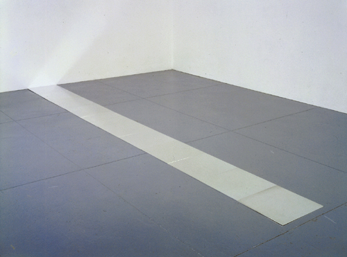 CARL ANDRE<br /><i>Eleventh Aluminum Cardinal</i><br />1978<br />aluminum<br />eleven units: 3/8 x 19-6/8 x 19-6/8 inches (.5 x 50 x 50 cm) (each)<br />overall: 3/8 x 19-6/8 x 216-1/2 inches (.5 x 50 x 250 cm)<br />