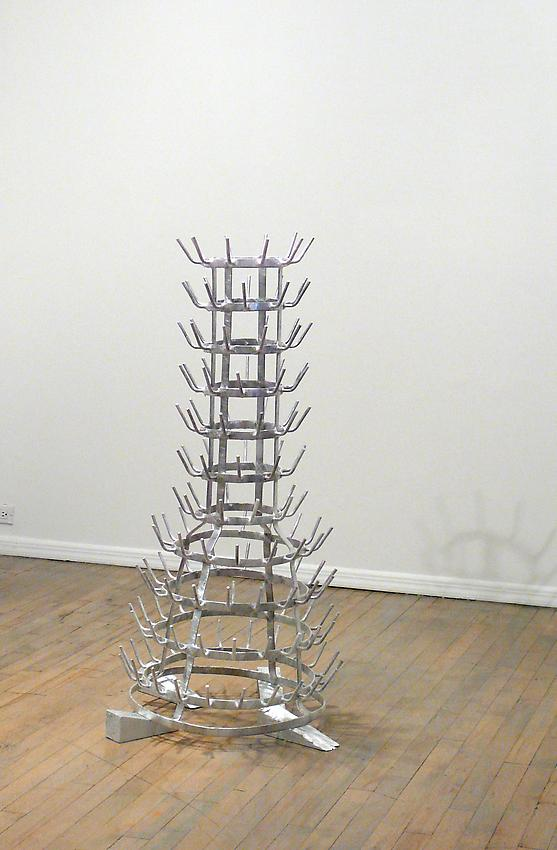 Richard Wentworth<br />The Exceptionally Long Letter<br />2010<br />galvanised steel bottle rack, plastic wrap and painted wood<br />48 x 25 1/2 x 25 1/4 inches<br />  (122 x 65 x 64 cm)<br />