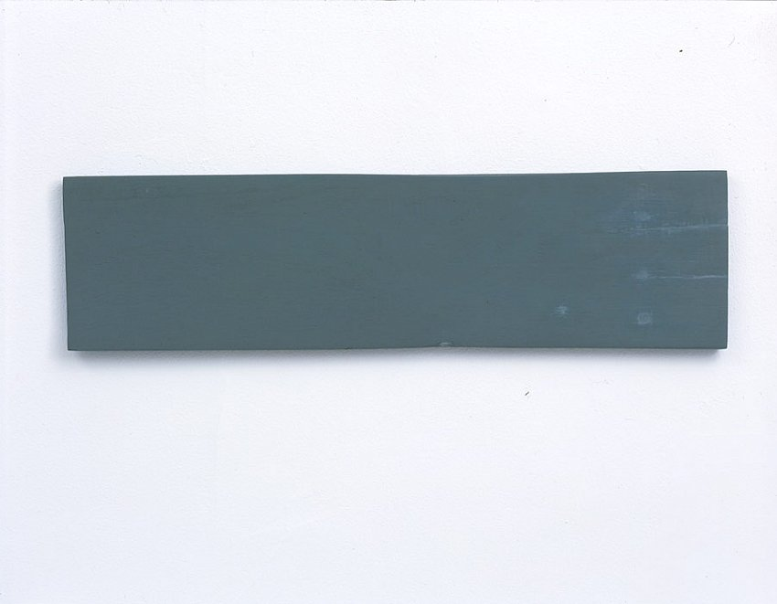 Helen Mirra<br />Third percent<br />2003<br />milk paint and putty on wood<br />5 ½ x 21 1/4 x 5/8 inches<br />(14 x 54 x 1.6 cm)<br />