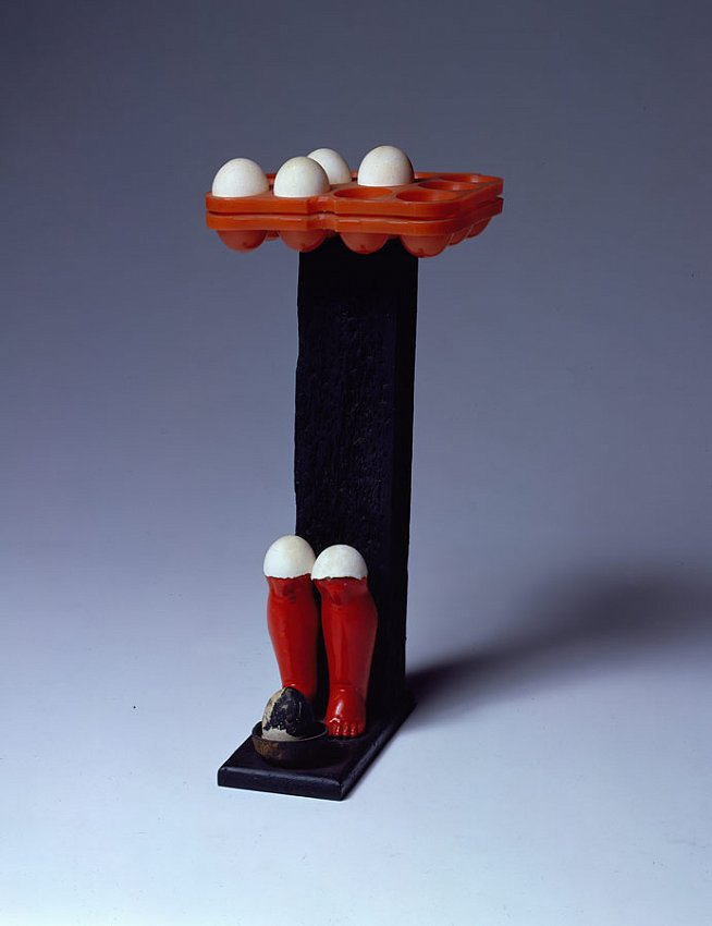 MARCEL BROODTHAERS		(1924 - 1976)<br /><i>Les Jambes rouges</i><br />1964<br />paint on wood, plastic, doll's legs, and eggs<br />19 x 8 1/4 x 9 inches (48.26 x 20.96 x 22.86 cm)<br />