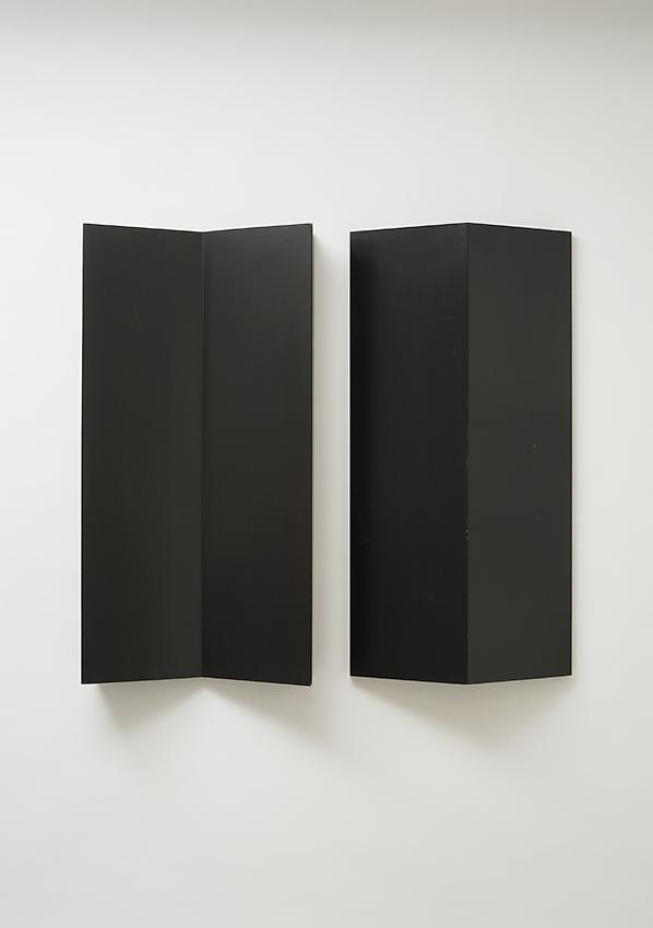 Charlotte Posenenske<br />Relief, Series B, 1967<br />RAL black spray paint on sheet aluminum, concavely and convexly folded<br />39 3/8 x 19 5/8 x 5 1/2 inches<br />