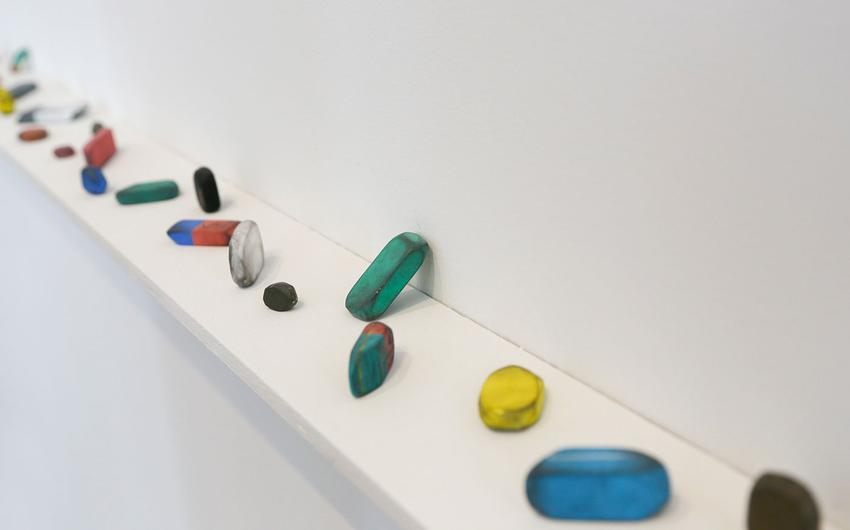 DAVID ADAMO<br /><i>Untitled (10 erasers)</i><br />2012<br />tempera on clay<br />dimensions variable<br />