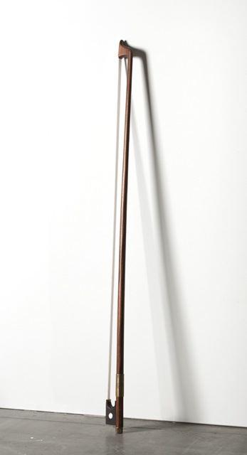 <u>Untitled</u><br />2012<br />wood, brass, and fishing line<br />57 7/8 x 3 1/8 x 1 inches (147 x 8 x 2.5 cm)<br />