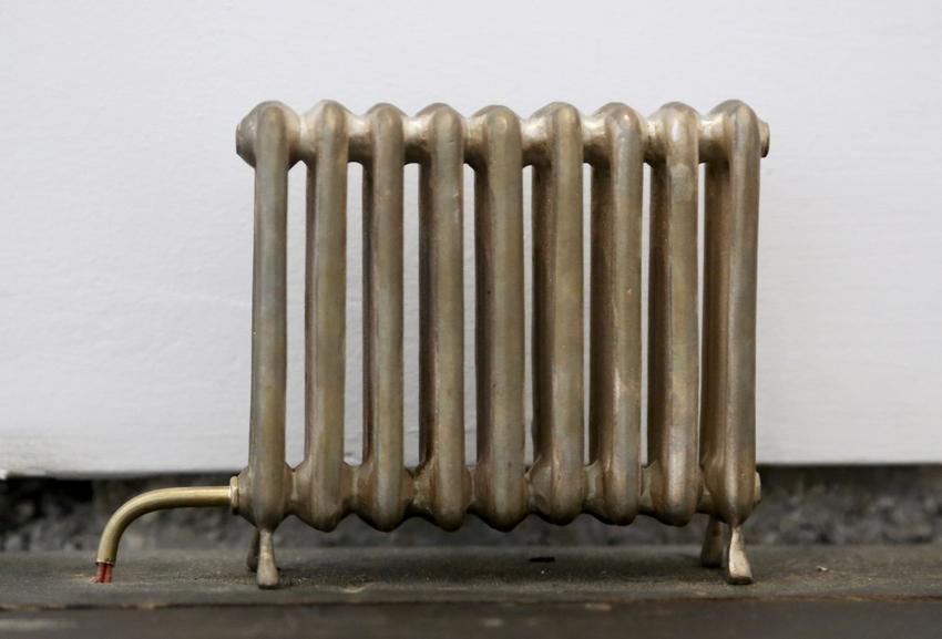 <u>Untitled (9 Ribs)</u><br />2013<br />bronze, electrical wiring<br />4 x 5 1/2 x 1 1/4 inches (10.2 x 14 x 3.18 cm)<br />Edition 2 of 2 + 1 AP<br />