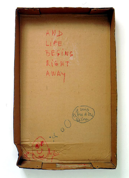 Robert Filliou<br />And Life Begins Right Away [je suis libre d'être libre]<br />c. 1973<br />pastel on cardboard box and glued paper label<br />26 1/2 x 16 1/4 x 3 7/8 inches<br />(67.3 x 41.3 x 9.8 cm)<br />