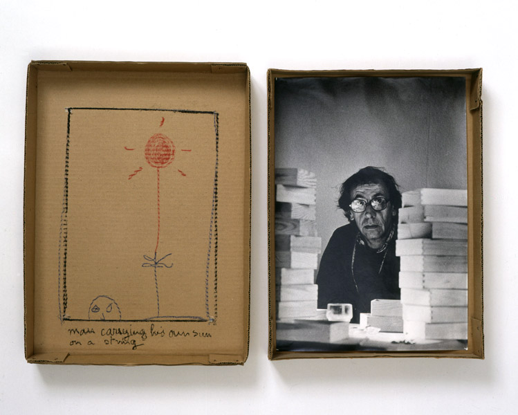 Robert Filliou<br />Man Carrying his Own Sun on a String<br />1973<br />cardboard box in two parts, photograph<br />and pastel<br />top: 17 5/8 x 13 x 2 1/4 inches<br />(44.8 x 33 x 5.7 cm)<br />bottom: 16 7/8 x 12 1/2 x 2 3/8 inches<br />(42.9 x 31.8 x 6 cm)<br />