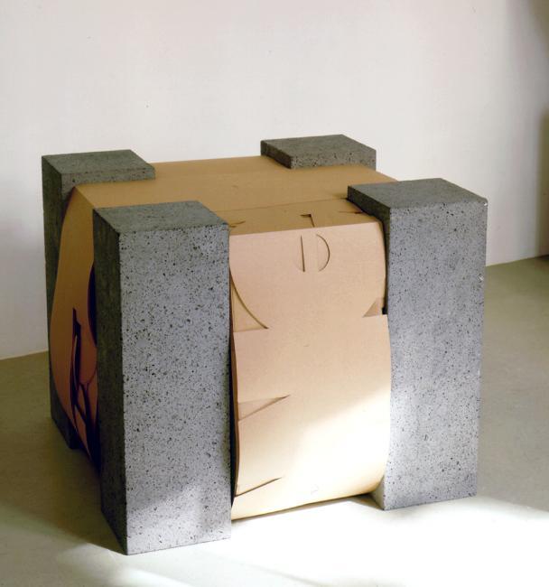 HARALD KLINGELHÖLLER<br /><i>Bühnenanweisung: Brüllt! </i>(Stage direction: Shouts!)<br />1997<br />basalt, paper<br />26 x 30 5/16 x 30 5/16 inches (66 x 77 x 77 cm)<br />