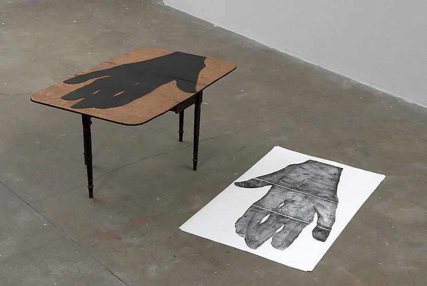 <u>Untitled</u> (Le Siege)<br />2009<br />wooden table, 2 etchings on paper (xylography)<br />table: 30 x 17 5/16 x 35 1/2 inches (71 x 44 x 90 cm)<br />each: 58 1/4 x 36 1/4 inches (148 x 92 cm)<br />