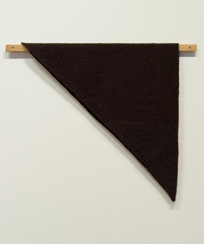 Helen Mirra<br /><br />Waulked Triangle, MT02/CT03d<br />2014<br />undyed wool from two black sheep, a strand of wool dyed with Boletopsis, cork, cedar<br />77.2 x 92.5 x 3.8 cm<br />PF3295<br />