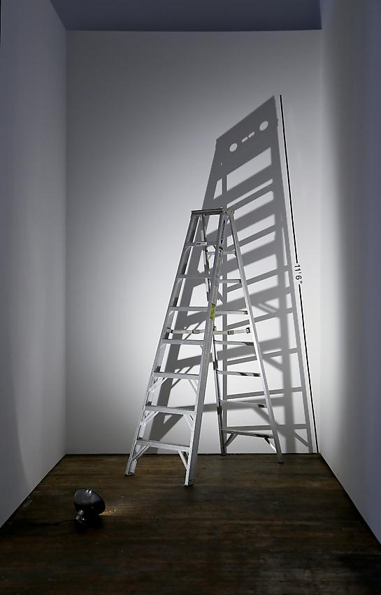 Mel Bochner<br />Measurement: Shadow<br />1969<br />ladder, lamp on floor, and vinyl on wall<br />size determined by installation<br />