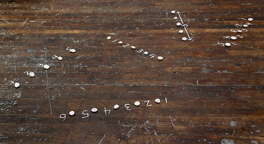 Mel Bochner<br />Five Sculptures<br />1972<br />stones and chalk on floor<br />size determined by installation<br />